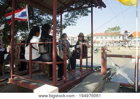 Asian People And Foreign Traveler Use Cable Car Across Chao Phraya River Visit And Pray Wat Niwet Th