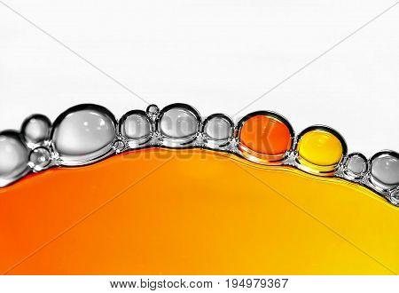 waterdrops photo in macro yellow and orange
