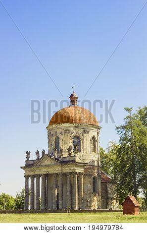 Old church of Exaltation 18th century near Pidhirtsi Castle against blue sky, Ukraine