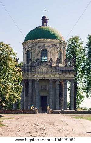 Old church of Exaltation 18th century near Pidhirtsi Castle in Ukraine, front view