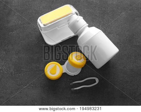 Set for contact lenses storage on gray background