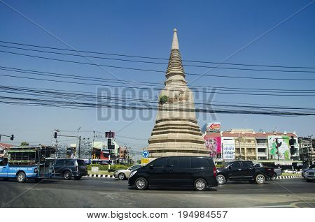 Asian Thai People Drive Vehicle On Traffic Road Go To Work And Visit Archaeological Site At Roundabo