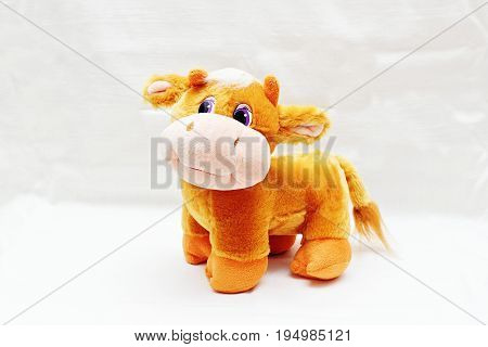 Soft toy nice cute cow isolated on white background.