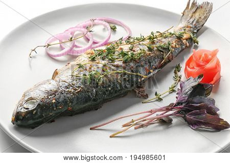 Plate with tasty fried fish, closeup