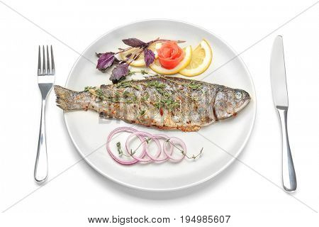 Plate with tasty fried fish and cutlery set on white background