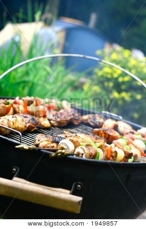 Sizzling Meat And Chicken On Hot Barbecue