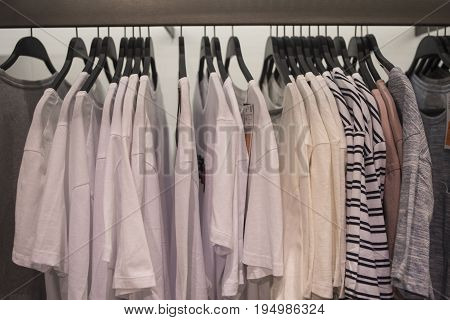 Men's T-shirts on hangers on the rack in the store