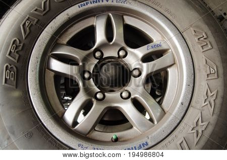 Wheel of a modern car transportation and vehicle waiting change wheels at local garage shop on December 19 2016 in Nonthaburi Thailand