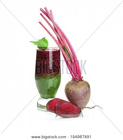 Glass of mixed smoothie with beet on white background