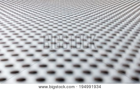 Gray metallic background with perforation of round holes and reflections