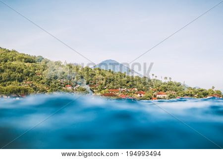 Blue water in tropical ocean and volcano Agung in Amed. Bali, Indonesia