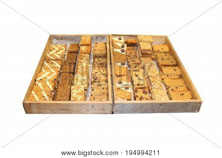 Two Wooden Trays of Freshly Baked Flapjack Slices.