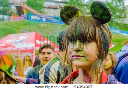 Moscow, Russia - June 3, 2017: Cosplay girl dressed in a Minni Mouse costume is powdered with multicolored dyes. Traditional Indian festival Holi turned into a fun event in many countries of the world