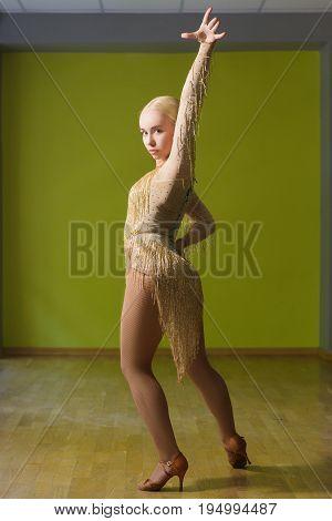 Beautiful woman dancing active ballroom dance in classroom.