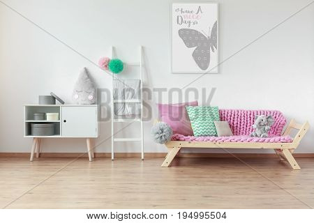 Modern wooden furniture in Scandinavian style in bright spacious kid room