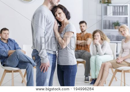 Group therapy session for couples with trust issues