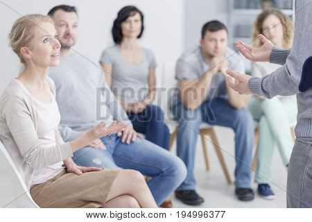 Woman psychologist speaking during group psychotherapy session