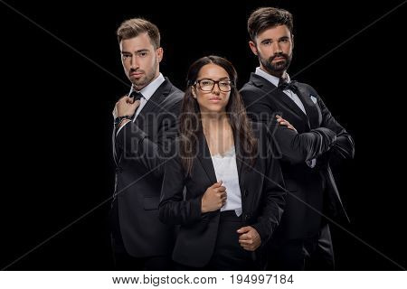 Confident Businesspeople Posing In Black Formal Wear, Isolated On Black