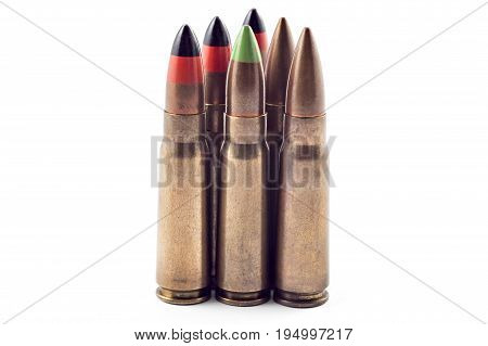 A selection of 7.62 bullets for kalashnikov, isolated on white. Bullets of different types: tracer, armor piercing...