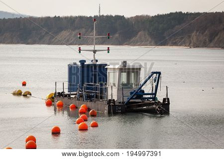 sand dredger boat near to the coast