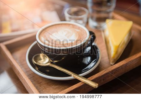 Cup coffee and set food and drink on wooden table in coffee shop at morning  .