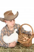 A farm boy with a basket of eggs. Space for copy poster