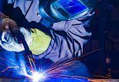 welder craftsman erecting technical steel Industrial steel welder in factory poster