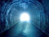 Blue tunnel with light coming from the exit. poster