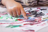 beautiful little baby girl draws a picture paints (postmodernism talent creativity creativity) poster