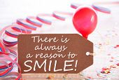 One Label With English Quote There Is Always A Reason To Smile. Party Decoration Like Streamer, Confetti And Balloon. Wooden Background With Vintage, Retro Or Rustic Syle poster