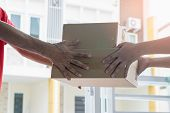 Delivery man are submitting the package to the recipient-Delivery and courier service concepts. poster