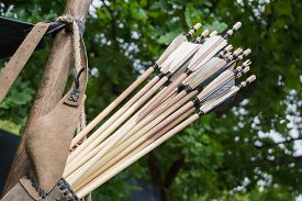 A Leather Quiver With Arrows In It.