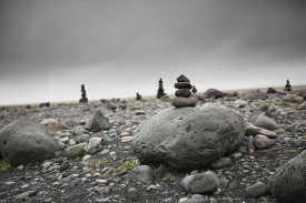 Stones in balance on top each other ina field of volcanic rocks