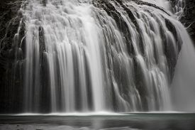 Waterfall shot with a long exposure method to generate motion blur effect