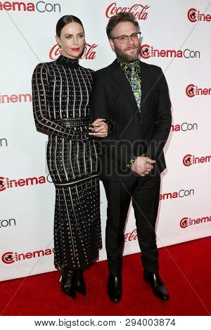 LAS VEGAS - APR 4: Charlize Theron (L) and Seth Rogen attend The CinemaCon Big Screen Achievement Awards at OMNIA Nightclub at Caesars Palace during CinemaCon on April 4, 2019 in Las Vegas, Nevada.