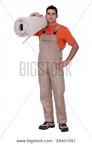 Man holding a roll of carpet