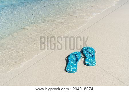 Flip Flops On White Sandy Tropical Beach, Summer Vacation And Travel Concept