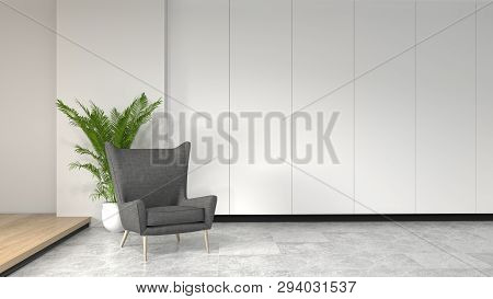 Armchair In Front Of Simple Clean White Wall With Decorative Items Empty Room,open Door,3d Rendering