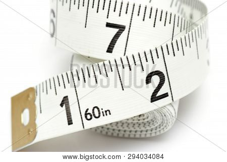 Close Up Of Tape Measure On White Background