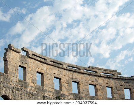 Roman Ruins Against Cloudy Sky In Pula. Croatia Amphitheater