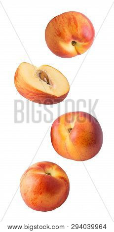 Falling Fresh Peaches Isolated On White Background