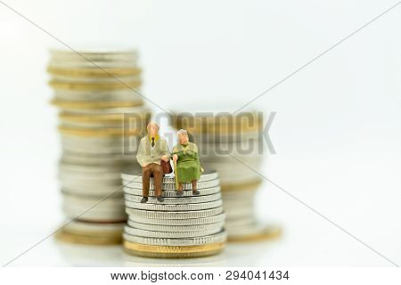 Miniature People: Happy Old People Standing On Coins Stack, Retirement Planning, Emergency Plan, Lif