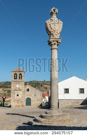 Portuguese Pillory And Church And Bell Tower From The 17th Century At Freixo Do Numao. Council Of Vi