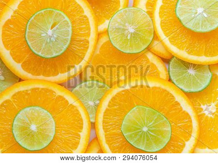 Abstract Background With Citrus-fruit Of Orange And Lime Slices. Close-up