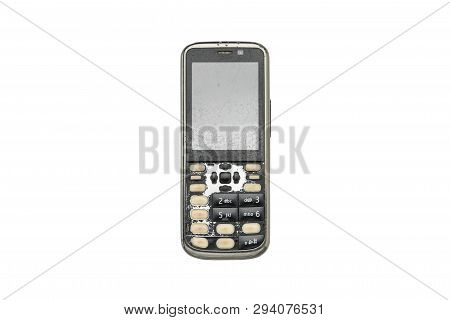 Very Old And Broken Mobile Phone, Isolated On White