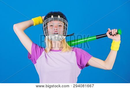 Girl Confident Pretty Blonde Wear Baseball Helmet And Hold Bat On Blue Background. Woman In Baseball