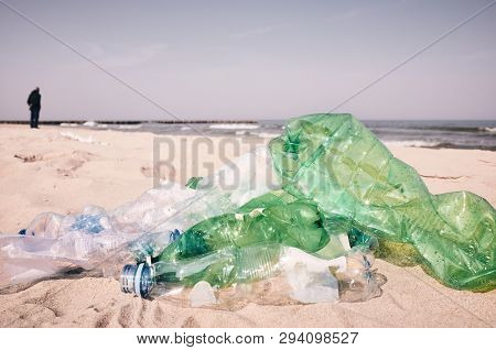 Used Plastic Bottles Left On A Beach By Tourists, Selective Focus, Color Toning Applied.
