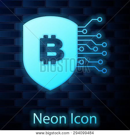 Glowing Neon Shield With Bitcoin Icon Isolated On Brick Wall Background. Cryptocurrency Mining, Bloc