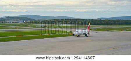 ZURICH, SWITZERLAND - CIRCA OCTOBER, 2018:  an Iberia aircraft taxing at Zurich International Airport.