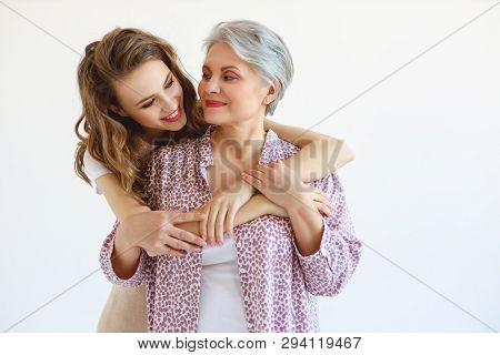 Happy Family Two Generations Old Mother And Adult Daughter On White Background